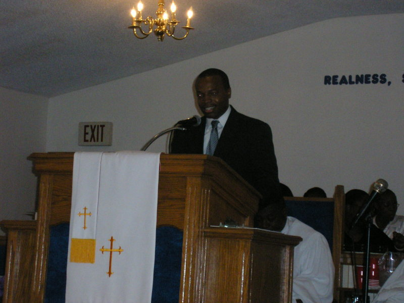 Mr. Johnnie giving a speach for local church